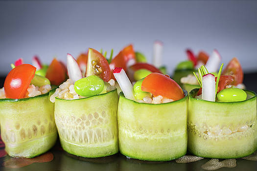 Cucumber rice rolls on plate by William Lee