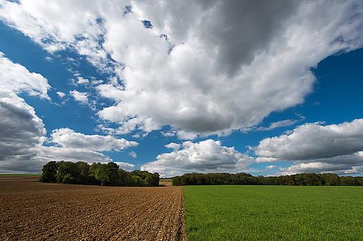 Cumulus skies in France by Wim Slootweg