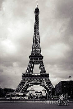 Cycling Past the Eiffel Tower by Marina McLain