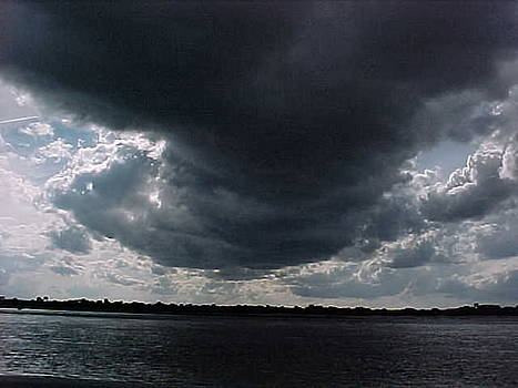 Dark moves across the land. by Ricky  Rayburn