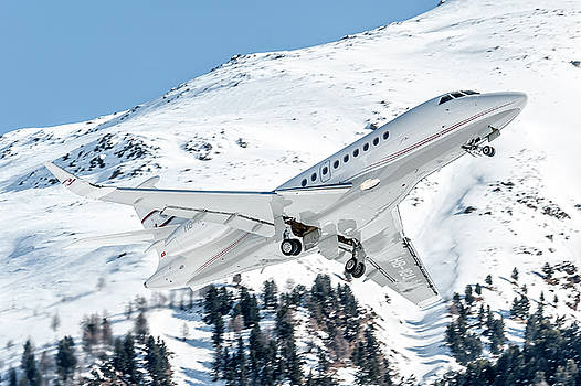 Dassault Falcon 2000 departed from St. Moritz Airport  by Roberto Chiartano