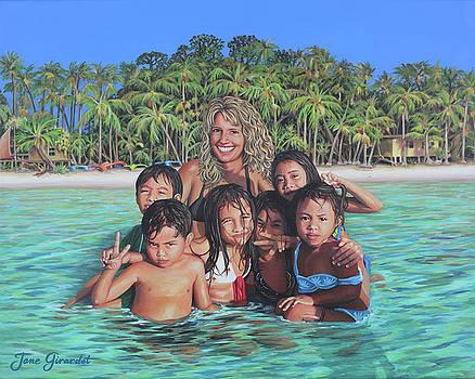 Deb and Filipino Children at the Beach by Jane Girardot