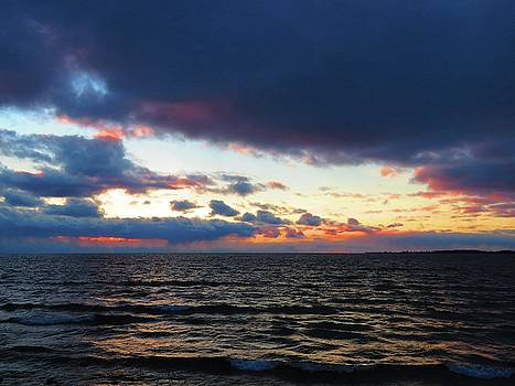December sunset, Wolfe Island, Ca. View from Tibbetts Point Lighthouse by Dennis McCarthy