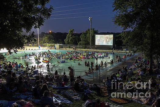 Herronstock Prints - Deep Eddy Pool Splash Movie Night Pool-goers take to the refreshing 70-degree water waters to enjoy a movie played on gigantic screen