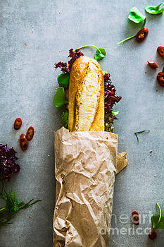 Deli sandwich with vegetables by Mythja Photography