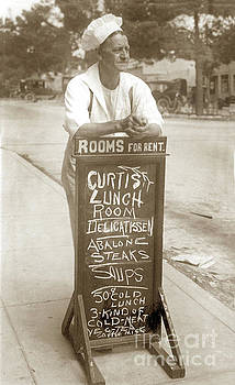 California Views Mr Pat Hathaway Archives - Delos C. Curtis  is leaning on his chalkboard Circa 1920