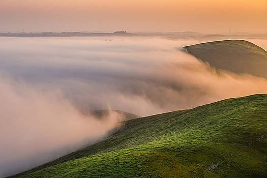 Marc Crumpler - dense fog against hills