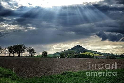 Desenberg castle ruins under the sunbeams by Eva-Maria Di Bella