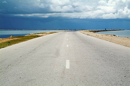 Sami Sarkis - Deserted rural road with the sea on either side