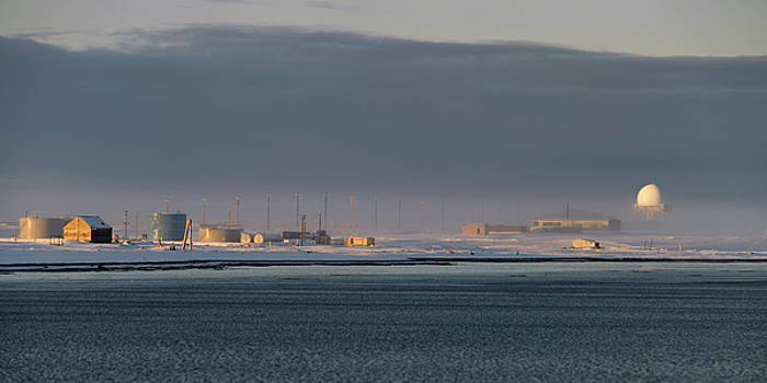 Reimar Gaertner - DEW line radar station and fuel tanks on Barter Island with fog