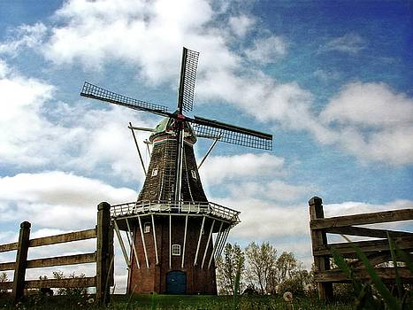 DeZwaan Windmill with Fence and Clouds by Michelle Calkins