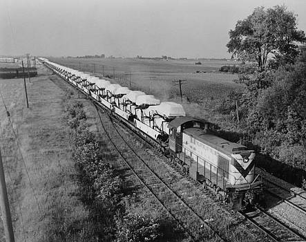 Engine 1033 Switching Rails - 1961 by Chicago and North Western Historical Society