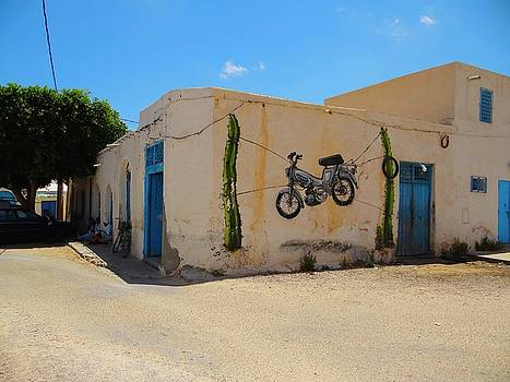 Djerba Street Art hanging scooter by Exploramum Exploramum