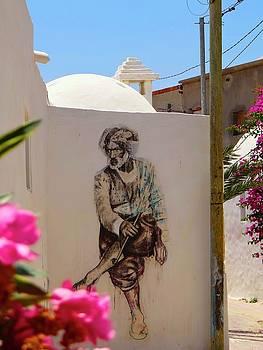 Djerba Street Art - Tunisia man with flower by Exploramum Exploramum