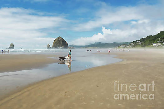 Dog walking at Cannon Beach by Maria Janicki