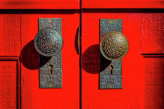 Doorknobs On Red Door by Garry Gay