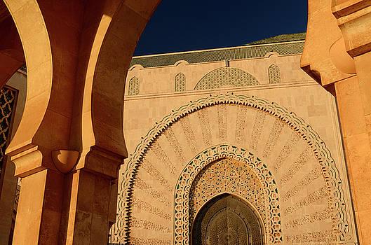 Reimar Gaertner - Doorway to the Hassan II Mosque Casablanca at sunset seen throug