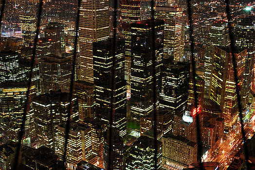 Reimar Gaertner - Downtown financial district highrise towers behind bars at night