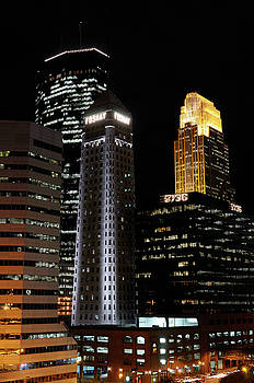 Reimar Gaertner - Downtown Minneapolis with lit highrise office towers after dark