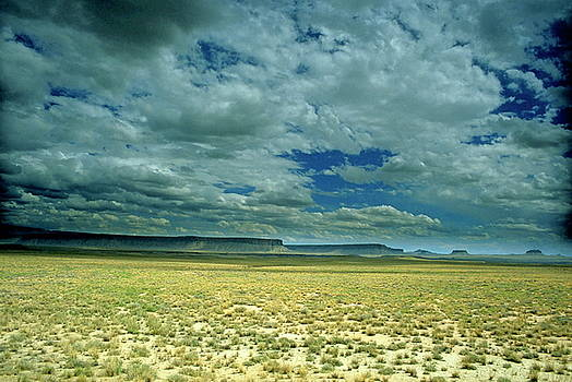 Sami Sarkis - Dramatic cloudy sky passing over the rock formations in Monument Valley