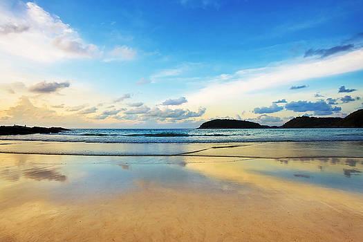 Dramatic Scene Of Sunset On The Beach by Setsiri Silapasuwanchai