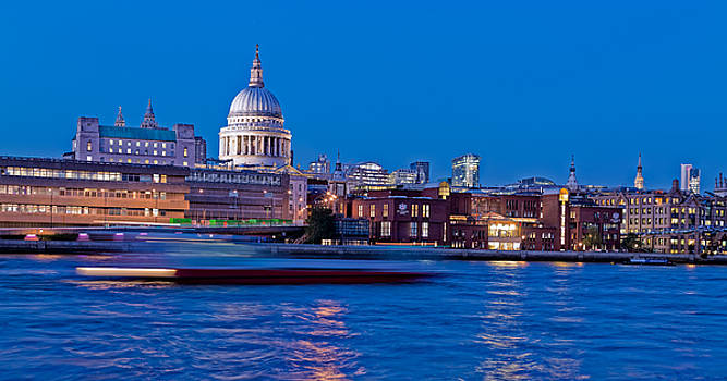 Drifting past St Pauls on the River Thames in London by Adrian Pollard