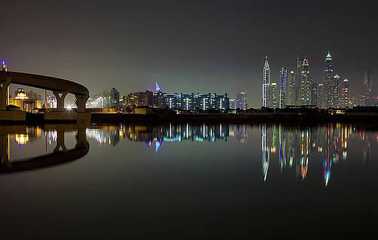 Dubai city skyline night time reflection by Andy Myatt