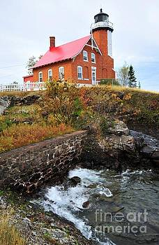 Terri Gostola - Eagle Harbor Lighthouse on Lake Superior