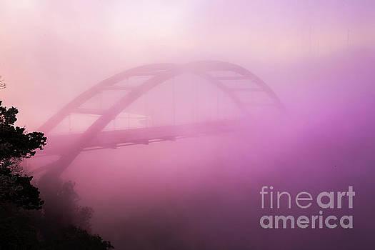 Herronstock Prints - Early morning fog paints the 360 Bridge during morning sunrise o
