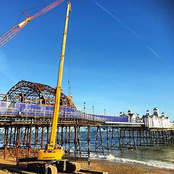 Crane at Eastbourne Pier  by Natalie Anne