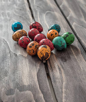 Easter concept. Quail eggs  on wooden background.Selective focus by Julian Popov