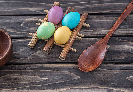 Easter eggs composition on wooden background by Julian Popov