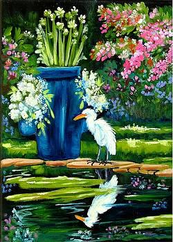 Egret visits goldfish pond by Carol Allen Anfinsen