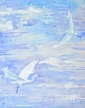 Egrets flying by Paola Correa de Albury