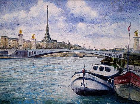 Eiffel Tower from the Seine with boats Paris France winter 2005  by Enver Larney