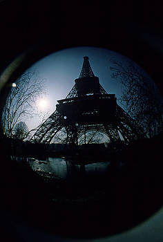 Sami Sarkis - Eiffel Tower surrounded by bare trees on a winter