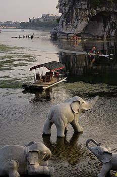 Reimar Gaertner - Elephant sculptures on the shore of the Li River at Elephant Tru