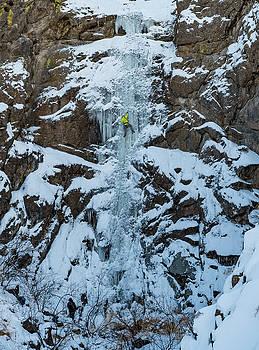 Elijah Weber climbs a route called Hidden Falls  by Elijah Weber