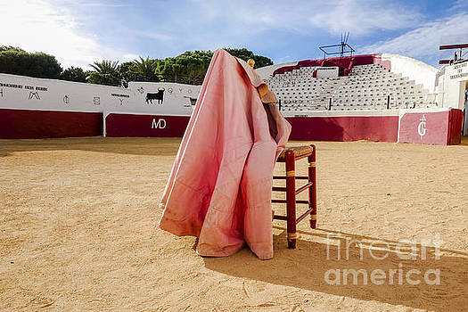 Empty Bullring, chair and cape by Perry Van Munster