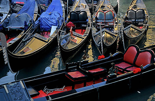 Sami Sarkis - Empty gondolas floating on narrow canal in Venice