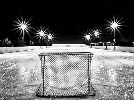 Empty outdoor rink at night W by Darcy Michaelchuk