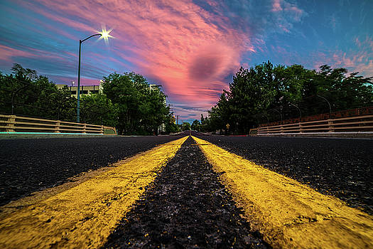 Epic Pink Summer Clouds Over Double Yellow Line on Ralston St. Bridge in Reno, Nevada by Brian Ball