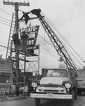 Chicago and North Western Historical Society - Erecting New Sign for Potato - Onion Mart