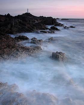 Evening tide, La Corbiere Lighthouse, Jersey by David Stanley