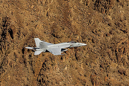 F18 Lighting Up Rainbow Canyon by Bill Gallagher
