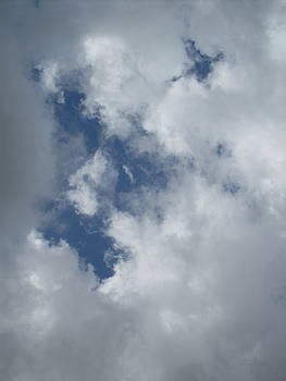 Face in cloud by John OBrien