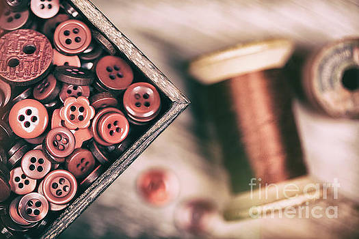 Faded retro styled red buttons and thread by Jane Rix