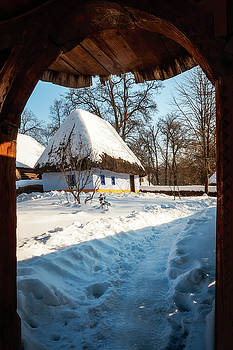 Fairytale cottage in winter at the Village Museum in Bucharest by Daniela Constantinescu
