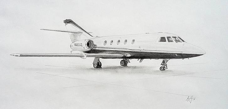 Falcon 20 alone on the ramp by Nicholas Linehan