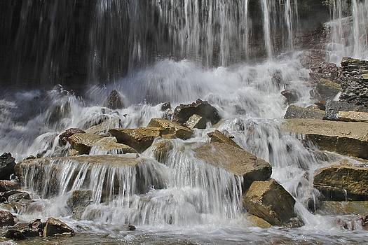 Falling over rocks by Crystal Socha